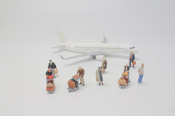 the Mini people of Travellers with airplane