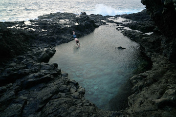 man jumps into tide pool