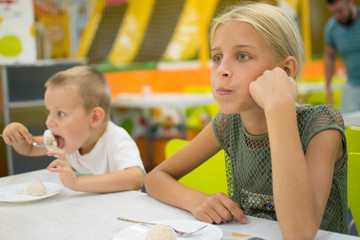children in a fast food restaurant
