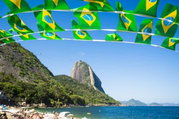 Brazilian flag bunting at Praia Vermelha Red Beach at Sugarloaf Mountain Pao de Acucar Rio de Janeiro Brazil Fototapete