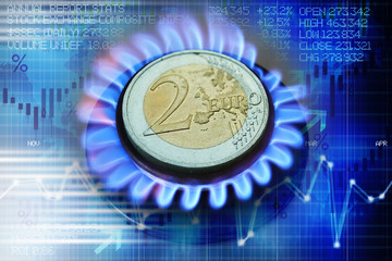 Euro coin on gas burner suggesting heating cost or natural gas price evolution