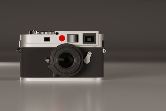 Front of Leica camera on gray semi-glossy floor