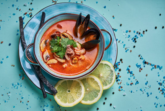 seafood soup in a blue plate