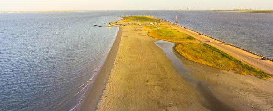 Panorama aerial view famous Texas City Dike, a levee that projects nearly 5miles south-east into mouth of Galveston Bay. It was designed to reduce the impact of sediment accumulation along lower Bay
