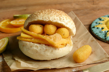 Zelfklevend Fotobehang Palermo sandwich with panelle - traditional street food of Sicily - made with chickpea flour