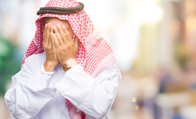 Young handsome man wearing keffiyeh over isolated background with sad expression covering face with hands while crying. Depression concept.