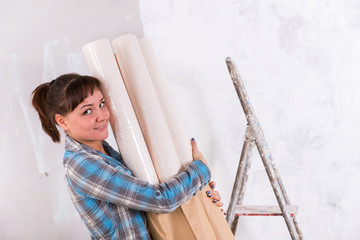 Pretty woman with wallpapers going repair house