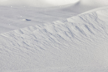 wavy drifts with snow