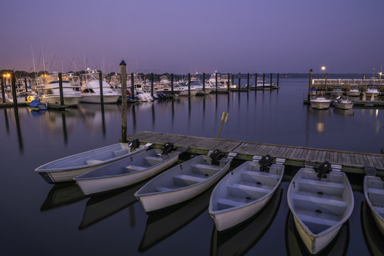 Belmar Marina in New Jersey at dawn, featuring boats on the foreground. Shot using long exposure