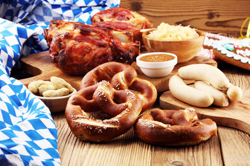 Foto auf Leinwand Sortiment Traditional German cuisine, Schweinshaxe roasted ham hock. Beer, pretzels and various Bavarian specialties. Oktoberfest background