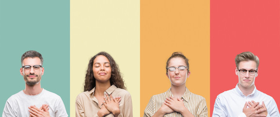 Collage of a group of people isolated over colorful background smiling with hands on chest with closed eyes and grateful gesture on face. Health concept.