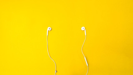 Wall Mural - earphone on yellow background business concept desk table