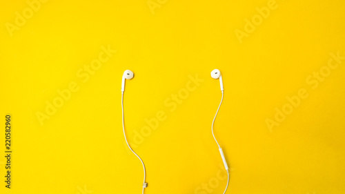 Wall mural earphone on yellow background business concept desk table