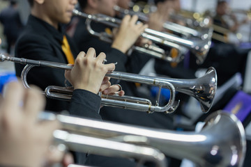 Close up Hand of trumpet player in Band,music instument concept