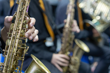 Close up Hand of Saxophone player in wind band,music instument concept