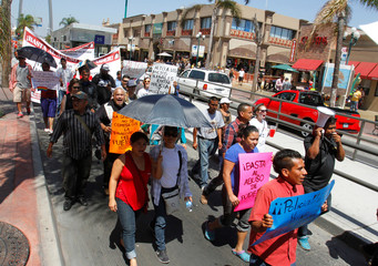 Members of the organization Pueblo Sin Fronteras and migrants from Central America take part in the March for Dignity in Tijuana