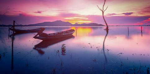 Fotobehang Lichtroze Wooden boat on water