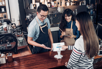 customer self service order drink menu with tablet screen and pay bill online at cafe counter bar,seller coffee shop accept payment by mobile.digital lifestyle concept.