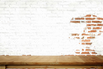 Empty wood table and white brick wall.