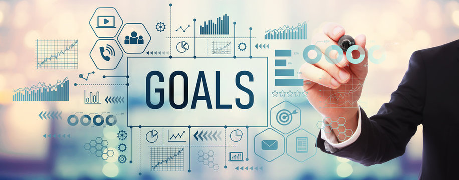 Goals with businessman on blurred abstract background