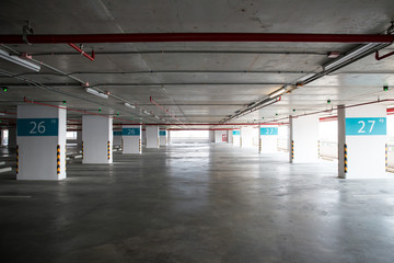 Empty space car park interior at afternoon.Indoor parking lot.interior of parking garage with car and vacant parking lot in parking building.some carpark empty in Condominium or department store.