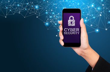Wall Mural - Cyber security concept. Cyber security on smartphone screen in businesswoman hand