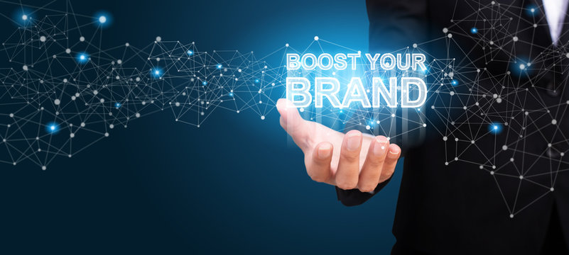 Boost Your Brand in the hand of business. Boost Your Brand concept