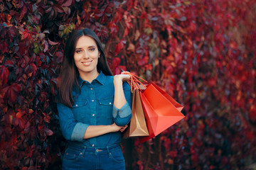 Happy Autumn Woman with Shopping Back Outdoors