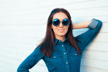 Stylish Autumn Girl in Denim Outfit Wearing Blue Matching Sunglasses