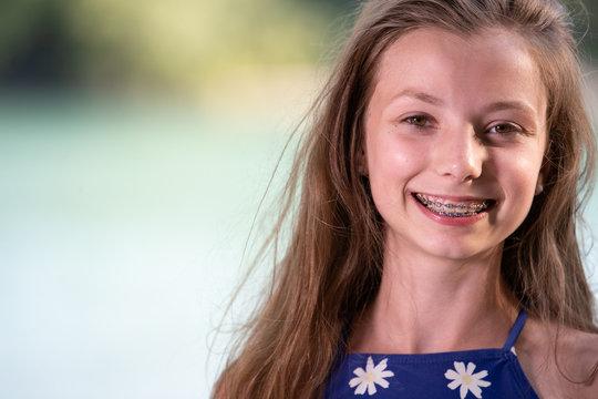 Teenage girl smiling with braces