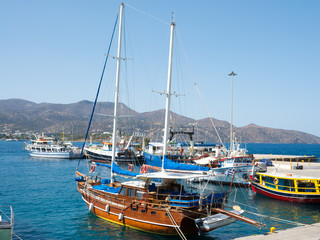 Agios Nikolaos. Crete. Ship at the pier on the waterfront Roussou Koundourou