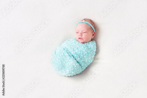 Newborn Baby Wrapped In Blue Blanket On White Background Stock