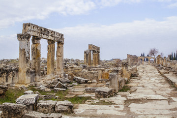 Columns and ruins of Hieropolis by a road in Pamukkale, Turkey