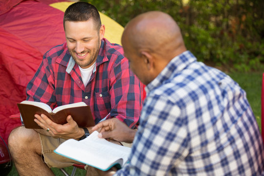 Men having a bible study.