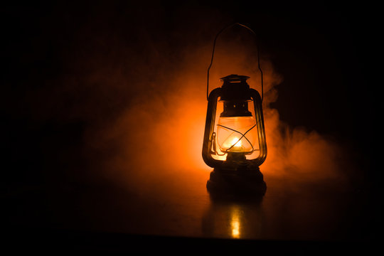 Oil Lamp Lighting up the Darkness or Burning kerosene lamp background, concept lighting. Selective focus