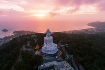 Aerial View drone shot of Big Buddha Statue on the high mountain at Phuket thailand in evening time.