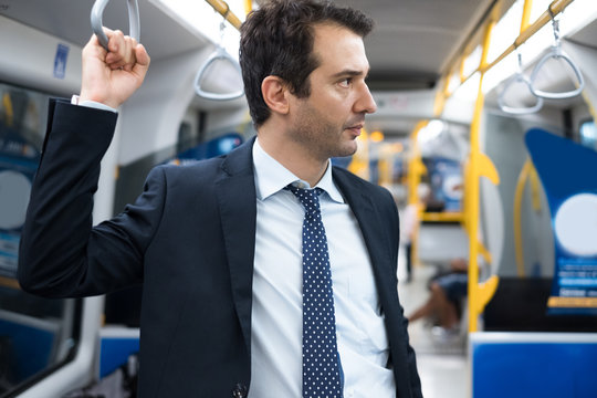 Commuter standing on a crowded underground