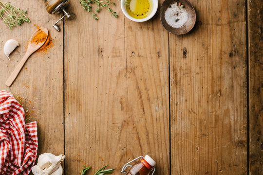 Spices and ingredients for cooking on wooden