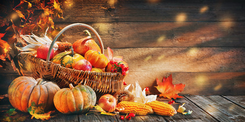 Aluminium Prints Autumn Thanksgiving pumpkins with fruits and falling leaves