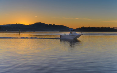 Sunrise Waterscape and Boat on the Bay