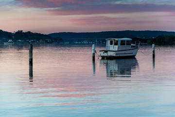 Pink Dawn Waterscape with Boat on the Bay