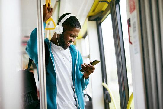 Man Using Phone, Listening Music Traveling In Train