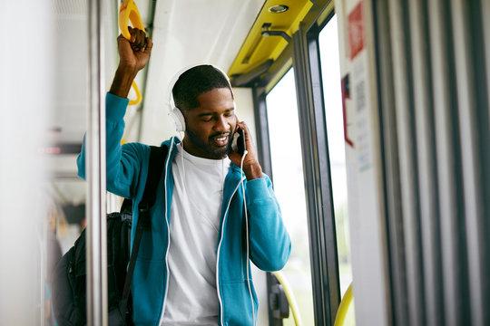 Man In Headphones Listening Music Riding In Transport
