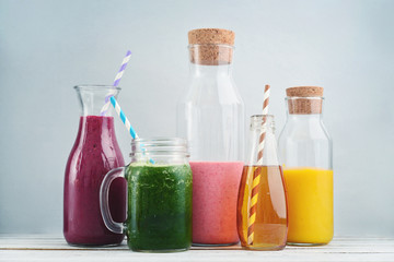 Orange, green and red colored smoothies