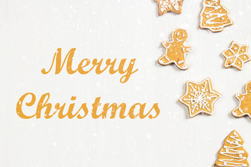 Christmas gingerbread cookies of different shapes on a white wooden table. Merry Christmas.