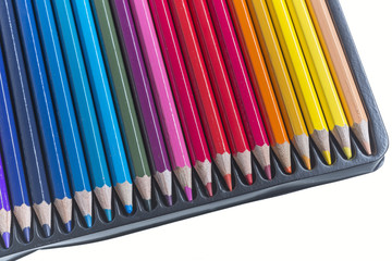 colored pencils in a box set isolated on a white background