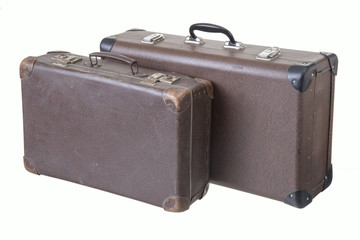 two different old vintage suitcases, isolated on white background