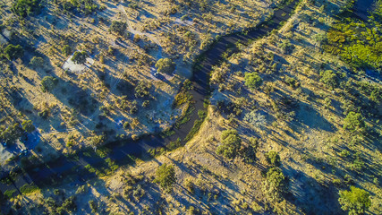Aerial view of simple bush campsite at Khwai River near Moremi National Park, Botswana, Africa