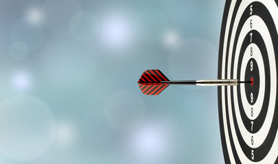 close-up dart arrow hitting on target center on bullseye in wooden dartboard with blurred blue lights bokeh copy space background, perfection goal success, symbol of aim and achievement