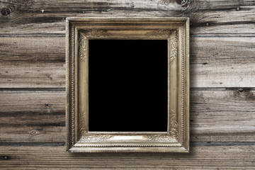 Old vintage gold ornate frame for picture on  wall